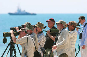 Birders in action at Zour Port (photo by Mike Pope)